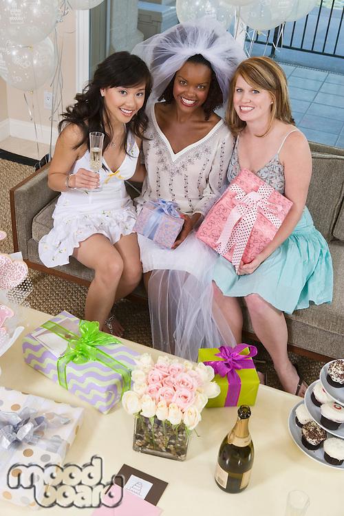 Bride with friends celebrating bridal shower