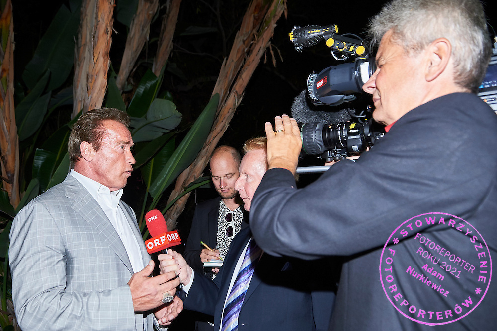 (R) Arnold Schwarzenegger Special Olympics Austria Honorary President speaks while TV interview on Austria 2017 Reception during third day of the Special Olympics World Games Los Angeles 2015 on July 27, 2015 in Los Angeles, USA.<br /> USA, Los Angeles, July 27, 2015<br /> <br /> Picture also available in RAW (NEF) or TIFF format on special request.<br /> <br /> For editorial use only. Any commercial or promotional use requires permission.<br /> <br /> Adam Nurkiewicz declares that he has no rights to the image of people at the photographs of his authorship.<br /> <br /> Mandatory credit:<br /> Photo by &copy; Adam Nurkiewicz / Mediasport