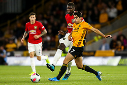 Paul Pogba of Manchester United takes on Pedro Neto of Wolverhampton Wanderers - Mandatory by-line: Robbie Stephenson/JMP - 19/08/2019 - FOOTBALL - Molineux - Wolverhampton, England - Wolverhampton Wanderers v Manchester United - Premier League