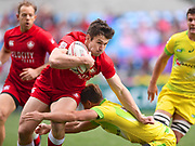 Canada player Pat Kay looks to break a tackle during the game Canada vs Australia during the Cathay Pacific/HSBC Hong Kong Sevens festival at the Hong Kong Stadium, So Kon Po, Hong Kong. on 7/04/2018. Picture by Ian  Muir.