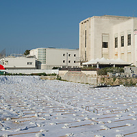 VENICE, ITALY - AUGUST 18: Polythene sheets cover the front of the New Palazzo del Cinema that stands very close to the present Palazzo del Cinema that will host the the Film Festival from August 31 on August 18, 2011 in Venice, Italy. The works at the new Palazzo del Cinema have stalled after it emerged that more than 15m euros were necessary to remove asbestos from the structure. (Photo by Marco Secchi/Getty Images))