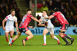 Joe Simmonds of Exeter Chiefs is challenged by Mark Atkinson of Gloucester Rugby and Ben Morgan of Gloucester Rugby - Mandatory by-line: Ryan Hiscott/JMP - 15/02/2019 - RUGBY - Kingsholm - Gloucester, England - Gloucester Rugby v Exeter Chiefs - Gallagher Premiership Rugby