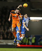 Ipswich Town striker Daryl Murphy (9) and Brighton central midfielder, Andrew Crofts (8) during the Sky Bet Championship match between Brighton and Hove Albion and Ipswich Town at the American Express Community Stadium, Brighton and Hove, England on 29 December 2015.