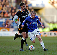 Photo: Leigh Quinnell.<br /> Leicester City v Hull FC. Coca Cola Championship. 04/03/2006. Leicesters Iain Hume gets past Hulls Damien Delaney.
