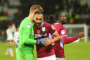Aston Villa midfielder Ahmed Elmohamady (27) celebrates after the final whistle with Aston Villa goalkeeper Orjan Nyland (1) during the EFL Sky Bet Championship match between Derby County and Aston Villa at the Pride Park, Derby, England on 10 November 2018.