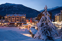 Whistler Village sparkles with lights and fresh snow on a winter evening.