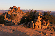 Several dramatic rock formations stand at the top of one of the hills in the Hartman Rocks Recreation Area near Gunnison, Colorado.