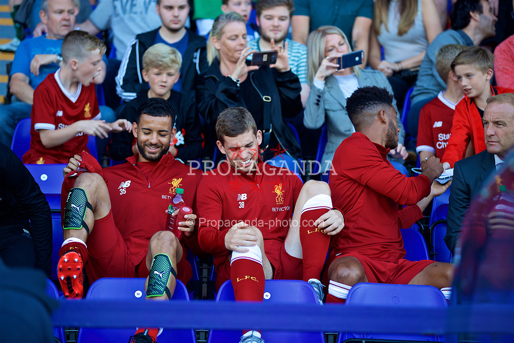 BIRKENHEAD, ENGLAND - Wednesday, July 12, 2017: Liverpool's substitutes Kevin Stewart, Jon Flanagan and Joe Gomez sit in the stands during a preseason friendly match against Tranmere Rovers at Prenton Park. (Pic by David Rawcliffe/Propaganda)