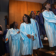 Eighth graders and their teacher Maureen Quinn, left, sing during their graduation ceremony at Joseph Leidy Elementary School in Philadelphia PA. Their's is the last graduating class at the school because it is one of 26 schools closed in the Philadelphia School District.  Photo by Lori Waselchuk