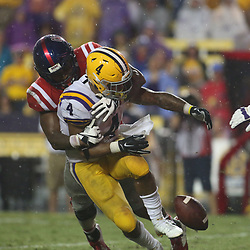 Sep 29, 2018; Baton Rouge, LA, USA; Mississippi Rebels defensive end Qaadir Sheppard (97) forces a fumble by LSU Tigers running back Nick Brossette (4) during the second half of a game at Tiger Stadium. Mandatory Credit: Derick E. Hingle-USA TODAY Sports