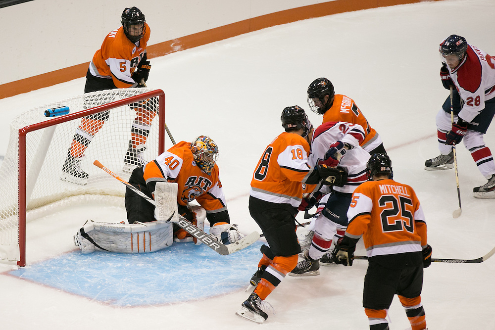 RIT's Jordan Ruby makes a save during a game against Brock University at the Gene Polisseni Center on Saturday, October 4, 2014.