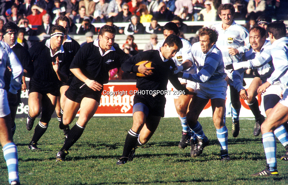 All Black second five John Schuster in action at the 2nd international rugby union test between the All Blacks and Argentina at Athletic Park, Wellington New Zealand, on Saturday 29 July, 1989. The All Blacks won the match 60-9. Photo: Bruce Jarvis/PHOTOSPORT<br />