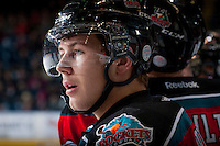 KELOWNA, CANADA - NOVEMBER 23:  Tyson Baillie #24 of the Kelowna Rockets stands on the bench opposite the  Regina Pats at the Kelowna Rockets on November 23, 2012 at Prospera Place in Kelowna, British Columbia, Canada (Photo by Marissa Baecker/Shoot the Breeze) *** Local Caption *** Tyson Baillie;