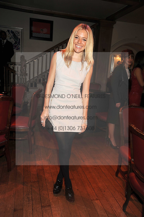 SIENNA MILLER at a party to celebrate the launch of Hollywood Domino - a brand new board game, held at Mosimann's 11b West Halkin Street, London on 7th November 2008.  The evening was in aid of Charlize Theron's Africa Outreach Project.
