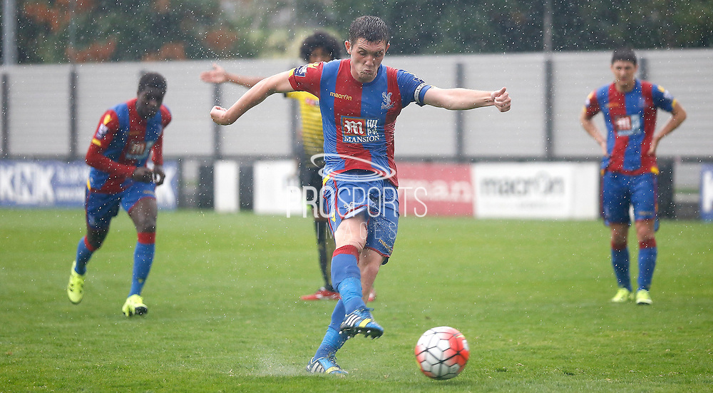 Connor Dymond firing in Palace's sixth from the spot during the Final Thirds Development League match between U21 Crystal Palace and U21 Watford at Selhurst Park, London, England on 24 August 2015. Photo by Michael Hulf.