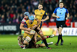 Jordan Crane (capt) of Bristol Rugby is tackled by Mariano Galarza of Gloucester Rugby - Rogan Thomson/JMP - 03/12/2016 - RUGBY UNION - Kingsholm Stadium - Gloucester, England - Gloucester Rugby v Bristol Rugby - Aviva Premiership.