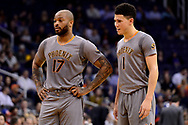 Feb 13, 2017; Phoenix, AZ, USA; Phoenix Suns forward P.J. Tucker (17) and guard Devin Booker (1) talk half court in the first half of the NBA game against the New Orleans Pelicans at Talking Stick Resort Arena. Mandatory Credit: Jennifer Stewart-USA TODAY Sports