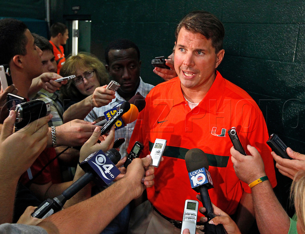 Coach Al Golden is interviewed by the media during Media Day for the University of Miami Football team on Campus in Coral Gables on August 27, 2011.