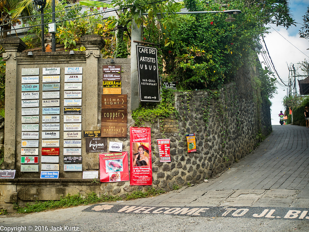 17 JULY 2016 - UBUD, BALI, INDONESIA:  Signs for hotels, restaurants and tourist shops at the head of a lane in Ubud, Bali.     PHOTO BY JACK KURTZ