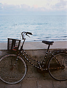 Bicycle against the seawall at the town beach near Pier 914.