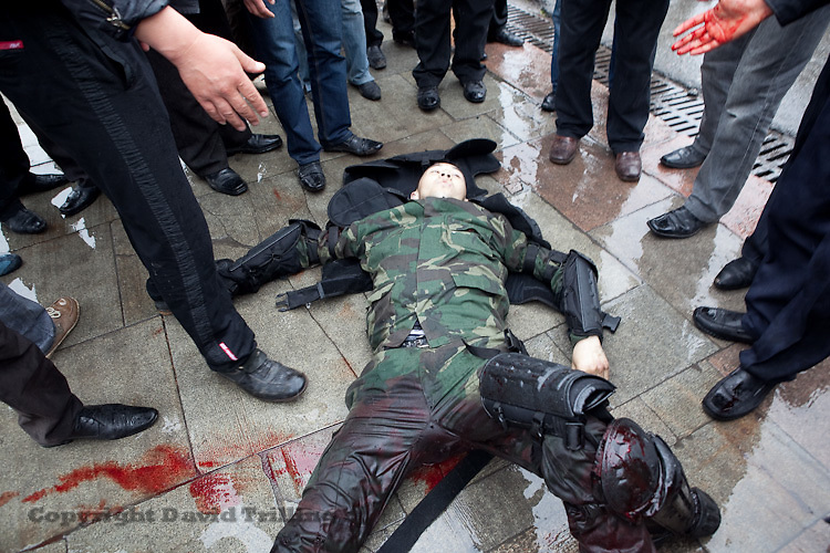 Calling for ouster of President Kurmanbek Bakiyev, rioters detained and beat police officers during an uprising in Bishkek, Kyrgyzstan on April 7, 2010. Approximately ninety police and demonstrators died in the chaos. Bakiyev fled that night.
