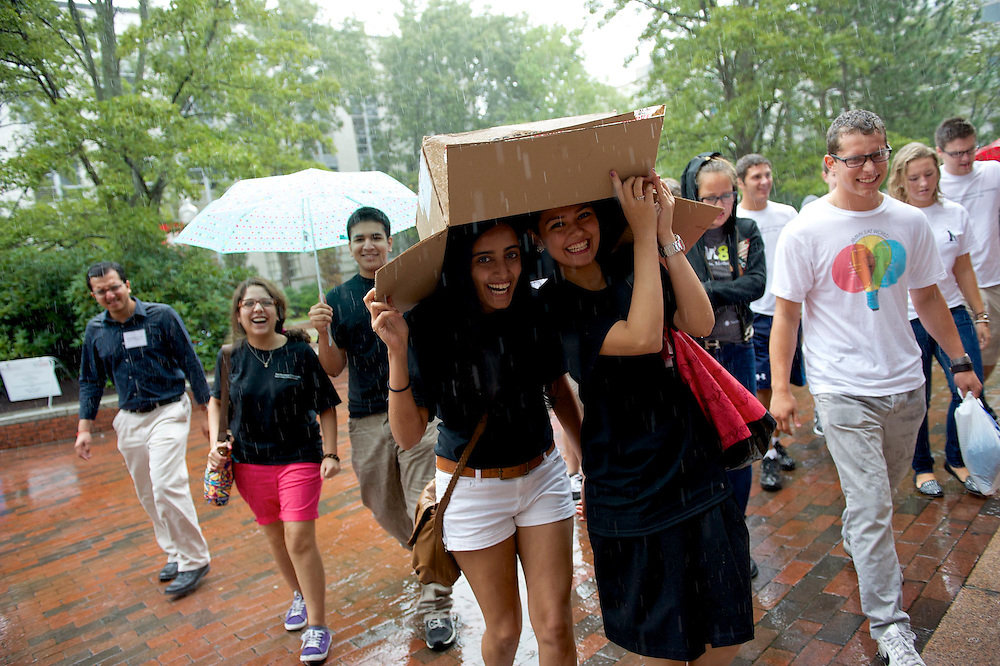 September 4, 2012 - Freshmen Juhi Daryanani, left, and Abrar Alturkistani, right, stay dry under a cardboard box while running from the President's Convocation in Matthews Arena for members of Northeastern's 115th class.