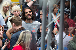 © Licensed to London News Pictures . 20/06/2015 . London , UK . RUSSELL BRAND in Parliament Square . Tens of thousands of people march from the Bank of England to Parliament , to protest economic austerity in Britain . Photo credit: Joel Goodman/LNP