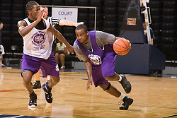PG Junior Cadougan (Humble, TX / Christian Life Center) dribbles past 2G Kenny Boynton (Plantation, FL / American Heritage).  The NBA Player's Association held their annual Top 100 basketball camp at the John Paul Jones Arena on the Grounds of the University of Virginia in Charlottesville, VA on June 20, 2008