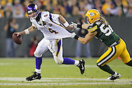 Green Bay Packers' Clay Matthews pressures Minnesota Vikings' Brett Favre in the 4th quarter Favre was able to throw the ball away. .The Green Bay Packers hosted the Minnesota Vikings at Lambeau Field Sunday October 24, 2010. Steve Apps-State Journal