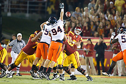 September 11, 2010; Los Angeles, CA, USA;  Virginia Cavaliers defensive end Matt Conrath (94) blocks a pass from Southern California Trojans quarterback Matt Barkley (7) during the first quarter at the Los Angeles Memorial Coliseum.