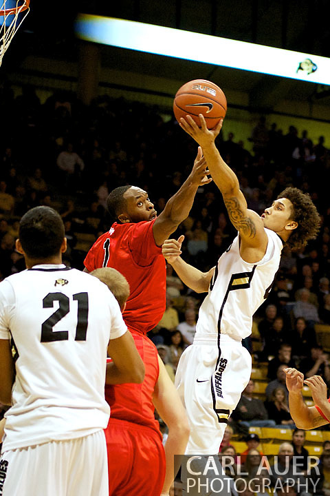 December 29, 2012: Finding his grove finally, Colorado Buffaloes sophomore guard ASKIA BOOKER (0) finger rolls a shot up in first half action of the NCAA Basketball game between the University of Hartford Hawks and the Colorado Buffaloes at the Coors Event Center in Boulder Colorado