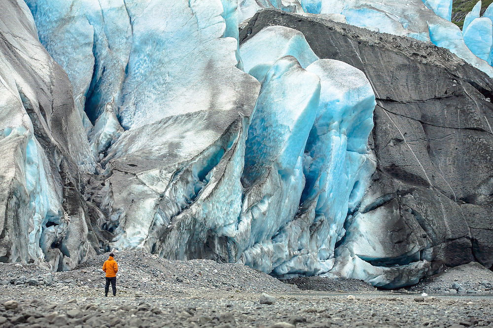 A man stands at the edge of Reid Glacier in southeast Alaska's Glacier Bay National Park.