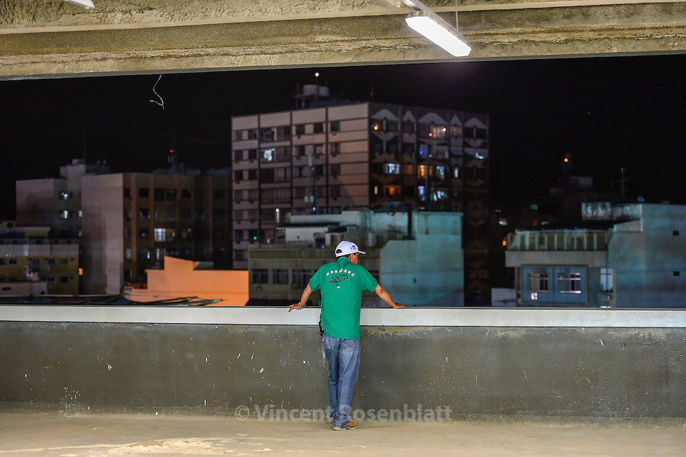 "A volunteer from the organization of the the reopening and test of the new Maracanã: construction workers and their families are invited to a meeting of retired players' friends of Ronaldo versus friends of Bebeto "". The stadium is tested at a third of its capacity."