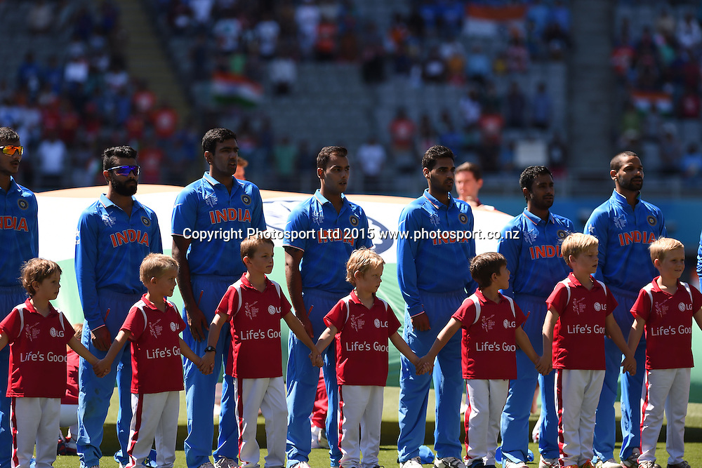 Indian Cricket team players lineup for their national anthem during the ICC Cricket World Cup match between India and Zimbabwe at Eden Park in Auckland, New Zealand. Saturday 14 March 2015. Copyright Photo: Raghavan Venugopal / www.photosport.co.nz
