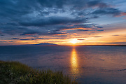 Dramatic sunset off the Alaskan coastline, Alaska, USA.