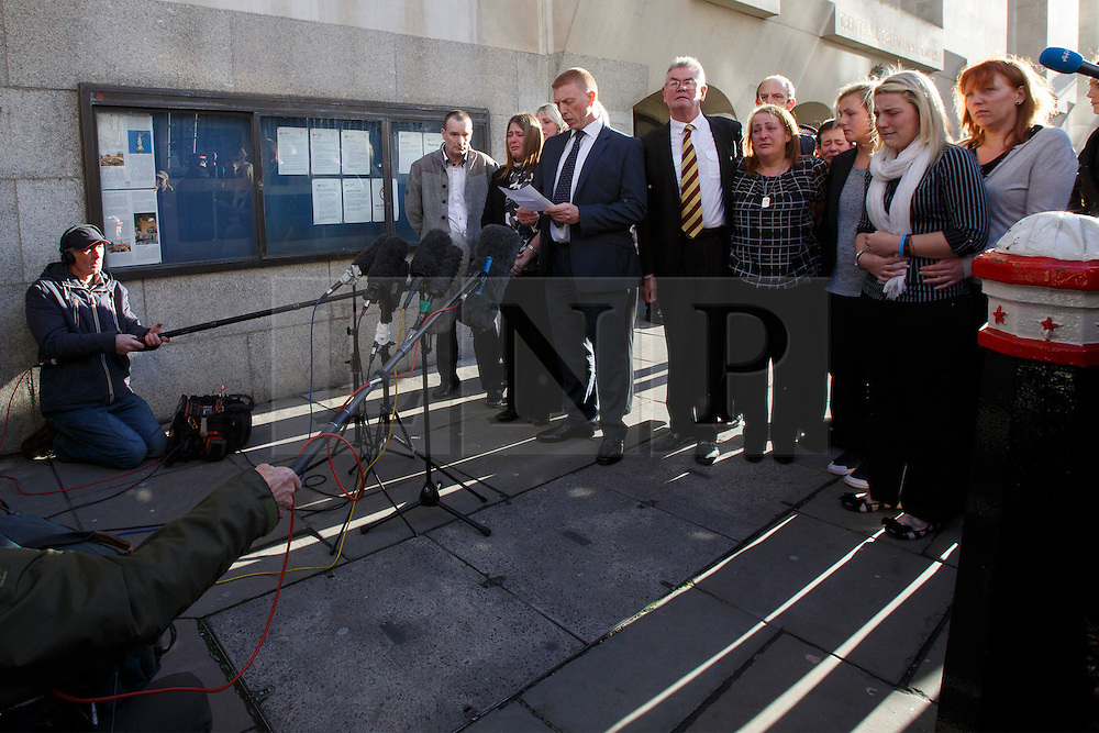 © licensed to London News Pictures. London, UK 19/12/2013. Family of murdered fusilier Lee Rigby giving a statement to media after the court found Michael Adebolajo and Michael Adebowale guilty of the murder of soldier Lee Rigby in Woolwich, south-east London in May. Photo credit: Tolga Akmen/LNP
