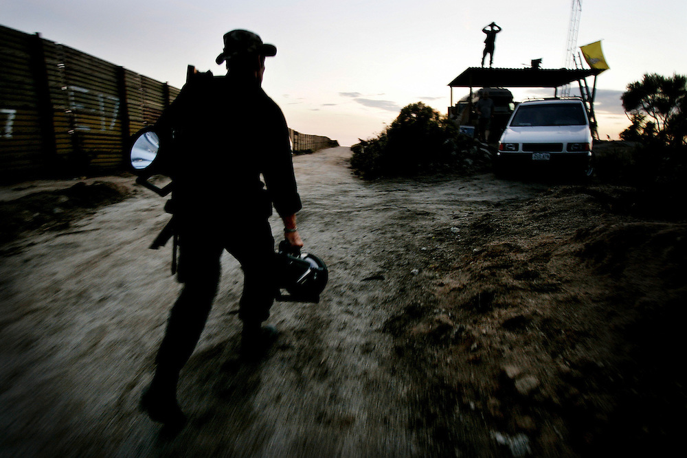 California Minutemen volunteer T.S. McMullen,L, heads back to camp after going on patrol along the U.S./Mexico Border in Campo, Calif.  on Thursday, August 4, 2005.  The controversial border-watch group has been staked out along parts of the California Border since July 16th in an attempt to stem the flow of illegal immigration and possible terrorist suspects trying to get into the United States