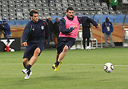 CAPE TOWN, SOUTH AFRICA - 13 JUNE 2010, Christian Maggio of Italy and Vincenzo Iaquinta of Italy challenge for the ball during Italy's training session held at the Cape Town Stadium. Italy play Paraguay in Match 11 of the 2010 FIFA World Cup on Monday 14 June 2010. Photo by: Shaun Roy/Sportzpics