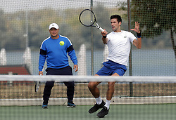 BELGRADE (SERBIA), Oct, 01, 2018  Serbia's tennis player Novak Djokovic (R) returns the ball, while his coach Marin Vajda (L) looks on, during open training session in Belgrade, Serbia on Oct, 01. 2018. (Credit Image: © Predrag Milosavljevic/Xinhua via ZUMA Wire)