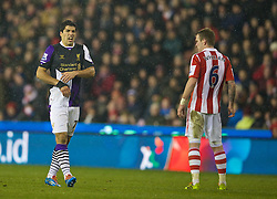 STOKE-ON-TRENT, ENGLAND - Sunday, January 12, 2014: Liverpool's Luis Suarez in action against Stoke City during the Premiership match at the Britannia Stadium. (Pic by David Rawcliffe/Propaganda)