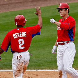 Mar 12, 2013; Clearwater, FL, USA;  Philadelphia Phillies designated hitter Chase Utley (26) hits a two run homerun scoring Ben Revere (2) during the bottom of the fifth inning of a spring training game against the Detroit Tigers at Bright House Field. Mandatory Credit: Derick E. Hingle-USA TODAY Sports