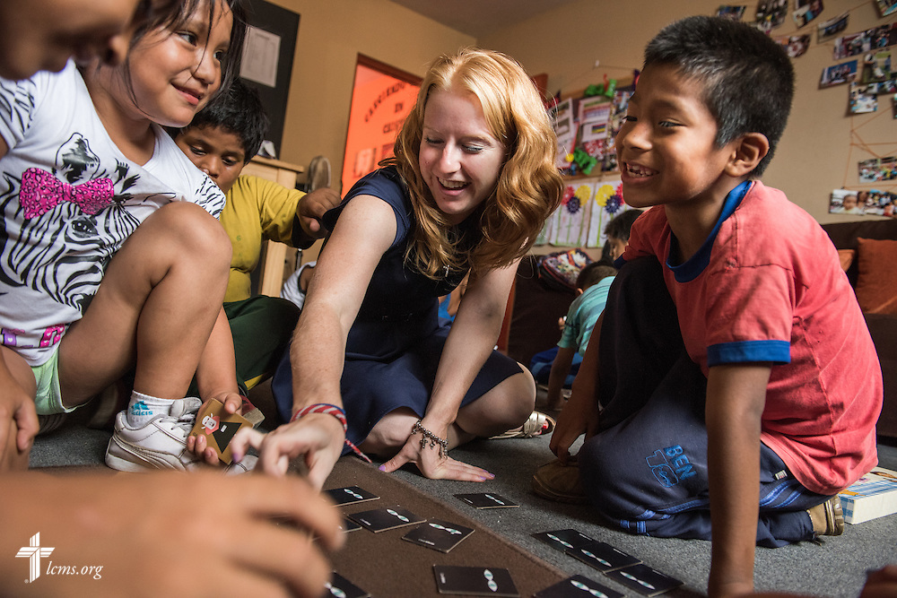 Deaconess Caitlin Worden plays with children during a game at Castillo Fuerte on Wednesday, April 8, 2015, in La Victoria, Peru. LCMS Communications/Erik M. Lunsford