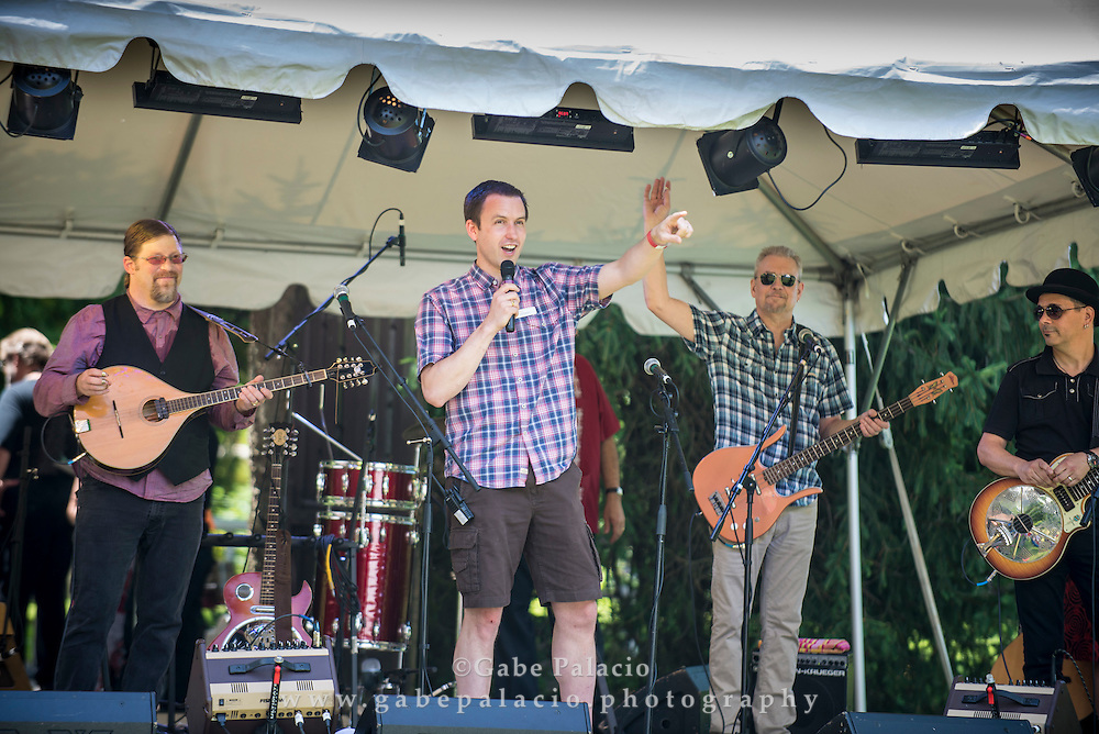Jeff Haydon, Caramoor CEO, opens the day with Spuyten Duyvil on the Friends Field set at the American Roots Music Festival at Caramoor in Katonah New York on June 28, 2014. <br /> (photo by Gabe Palacio)