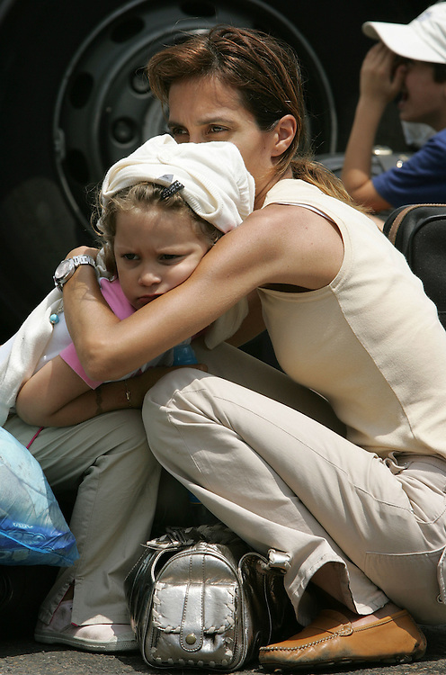 21 July 2006&amp;#xD;&amp;#xA;Beirut, Lebanon&amp;#xD;&amp;#xA;French evacuees.&amp;#xD;&amp;#xA;&amp;#xD;&amp;#xA;On the 21st July 2006 a mother and her children join other French nationals in Beirut port as they wait to board a Greek ferry sailing to Larnaca in Cyprus. The ferry arrived loaded with humanitarian ain and NGO workers.<br />