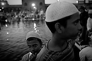 Indian Muslims gather after evening prayers as they break fast on one of the last days of Ramadan at the Jama Masjid on September 19, 2009 in New Delhi, India. Muslims all over the world are preparing for the end of the fasting month of Ramadan which is marked by the celebration of Eid al-Fitr, dependent on the sighting of the new moon. Photo by Keith Bedford