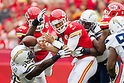 KANSAS CITY, MO - SEPTEMBER 30:  Matt Cassel #7 of the Kansas City Chiefs is hit by Melvin Ingram #54 of the San Diego Chargers at Arrowhead Stadium on September 30, 2012 in Kansas City, Missouri.  The Chargers defeated the Chiefs 37-20.  (Photo by Wesley Hitt/Getty Images) *** Local Caption *** Matt Cassel; Melvin Ingram Sports photography by Wesley Hitt photography with images from the NFL, NCAA and Arkansas Razorbacks.  Hitt photography in based in Fayetteville, Arkansas where he shoots Commercial Photography, Editorial Photography, Advertising Photography, Stock Photography and People Photography