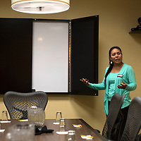 040115      Cayla Nimmo<br /> <br /> Sherlynn Kiely gives a tour of the boardroom at the Hilton Garden Inn in Gallup Thursday during the grand opening ceremony and tour. The hotel showed off its amenities and held a grand prize drawing for a flat screen television for people who visited the open rooms.