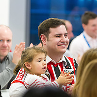 Fellow Brazilian Fan Henrique Peinado and his daughter Victoria watch Felipe Massa answering questions from the staff at Genworth, Shannon