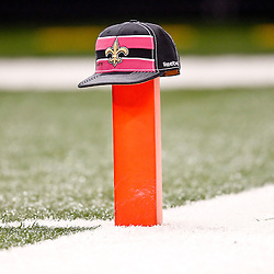 October 23, 2011; New Orleans, LA, USA; A pink New Orleans Saints cap sits on top of a goal line pylon prior to kickoff of a game between the New Orleans Saints and the Indianapolis Colts at the Mercedes-Benz Superdome. Mandatory Credit: Derick E. Hingle-US PRESSWIRE / © Derick E. Hingle 2011