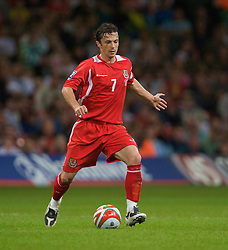 CARDIFF, WALES - Friday, September 5, 2008: Wales' captain Simon Davies in action against Azerbaijan during the opening 2010 FIFA World Cup South Africa Qualifying Group 4 match at the Millennium Stadium. (Photo by David Rawcliffe/Propaganda)